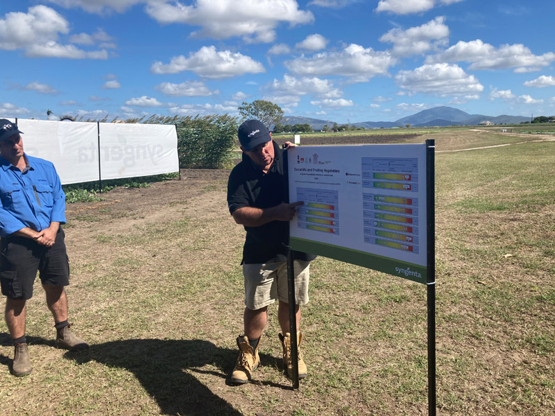 Man reading a chart in a field