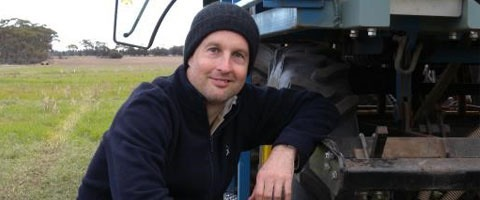 Plant pathologist Daniel Hüberli next to the seeder with the capacity for fungicide liquid banding