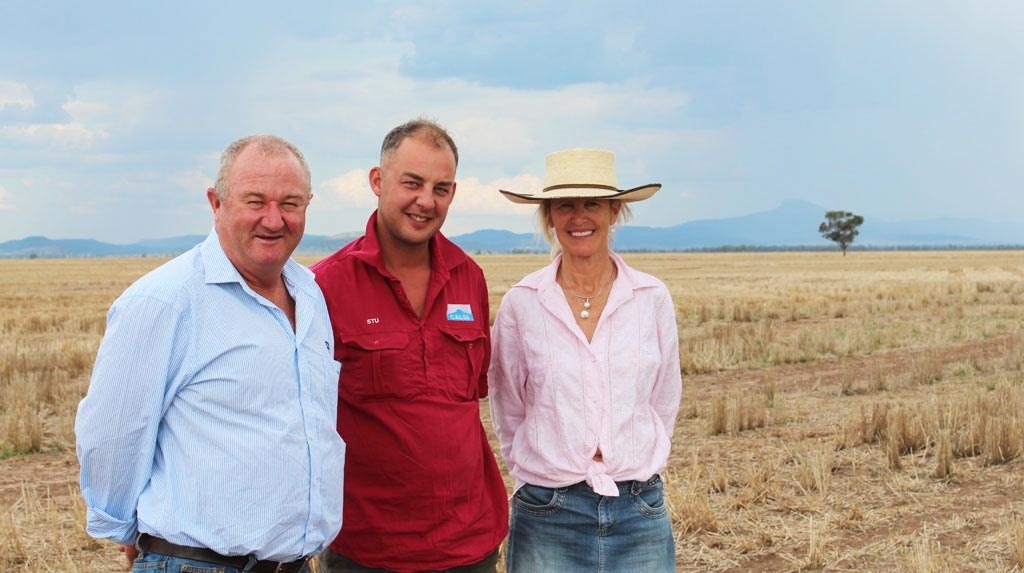 Graeme Callaghan, Stuart Davidson & Margie Pye standing in their La Trobe stubble at 'Calga', Coonamble NSW