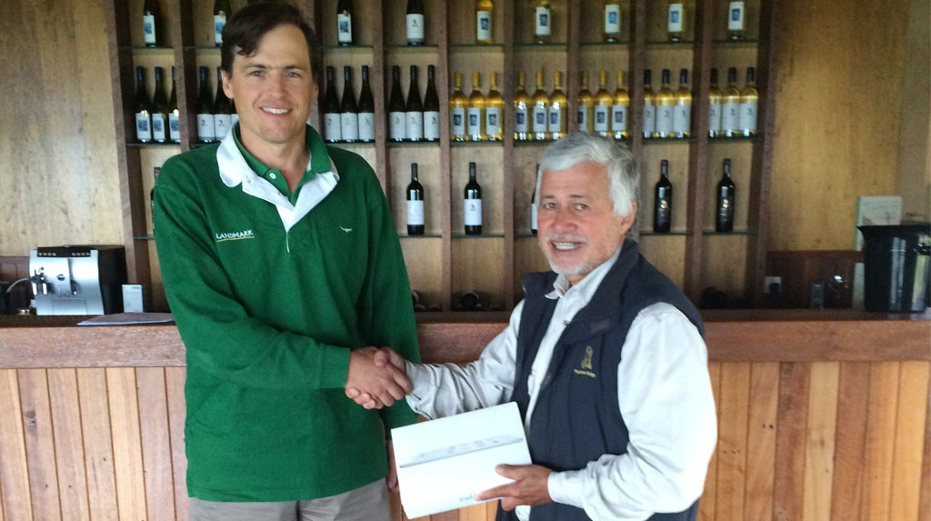 Alex Taylor accepting his prize from his local Landmark Agronomist, Steve Poole.