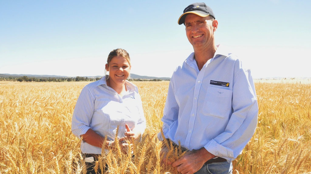 farmers smiling in front of field Pete Wilson from Lachlan Fertilizers Rural, Cowra (right) with Syngenta Territory Sales Manager, Emma McClelland in the BOXER GOLD treated paddock of Gregory wheat.