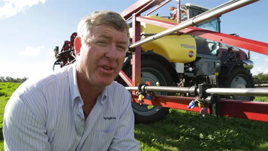 man sitting down in front of tractor